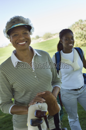african american female golfer smiling
