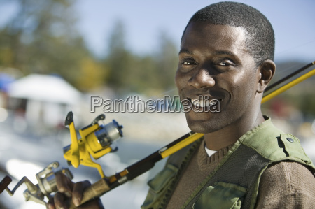 african american man with fishing rod