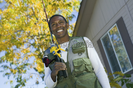 african american man with fishing rods