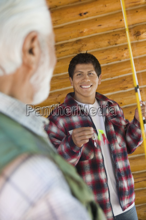 man with fishing equipments