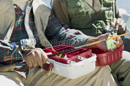 men with fishing equipments