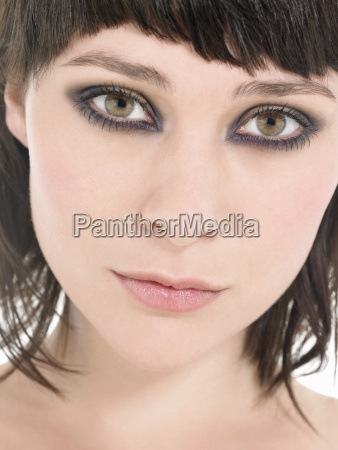 young woman wearing heavy eye makeup