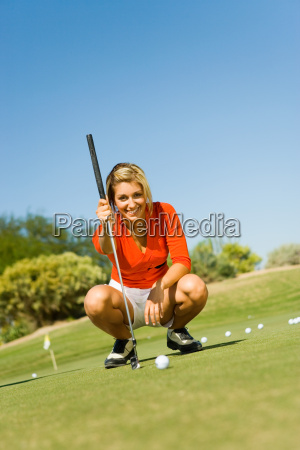 young woman on golf course