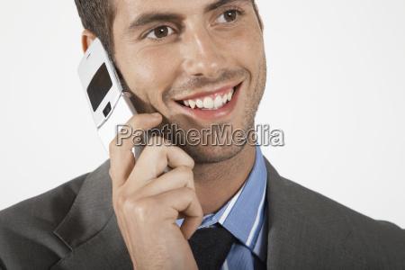 smiling businessman using mobile phone