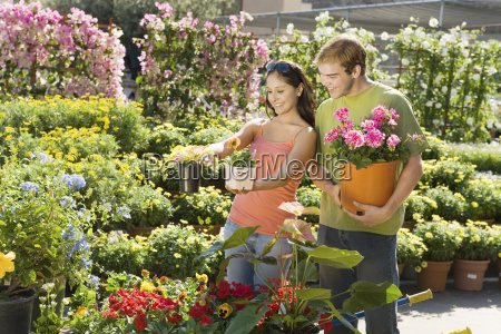 couple selecting potted plants