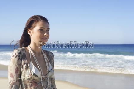 beautiful teenage girl looking away beach