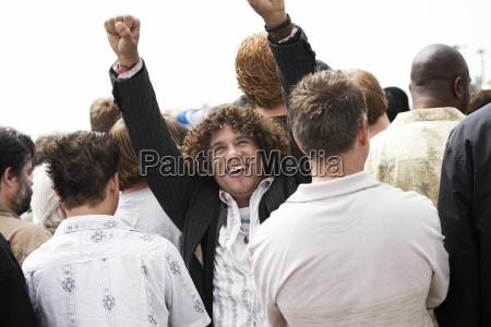 one happy man raising hands