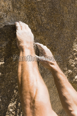 rock climbers hand grasping hold on