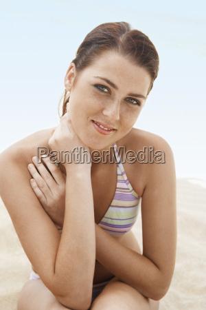 beautiful teenage girl in bikini sitting
