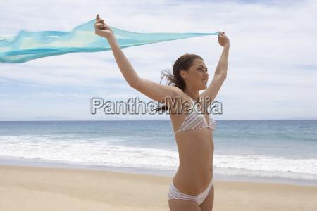 teenage girl in bikini with hands