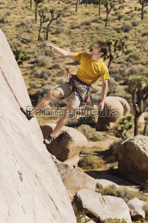 mature man rock climbing