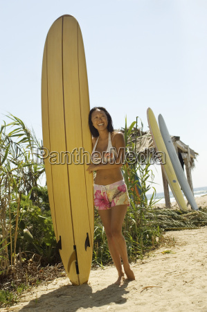 asian woman with surfboard