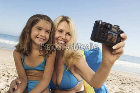 mother and daughter taking self portrait