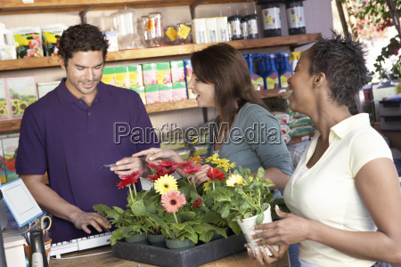 female friends buying potted plant