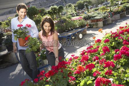 happy couple selecting flower plants