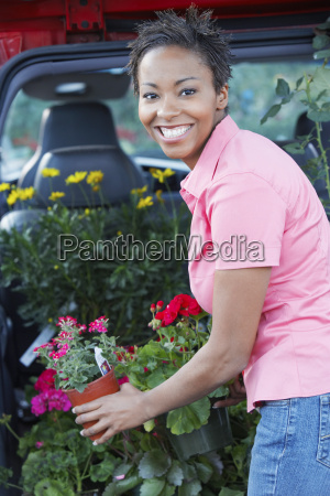 woman buying potted plants
