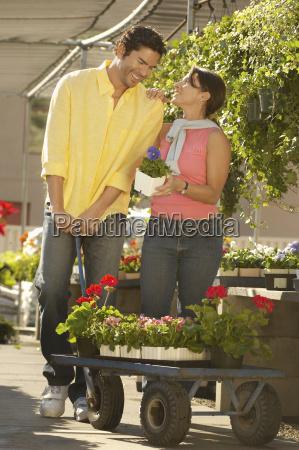 happy couple buying plants