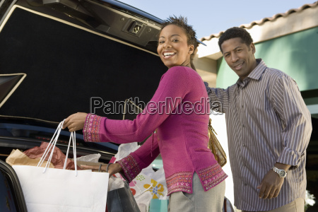 couple loading shopping bags in car