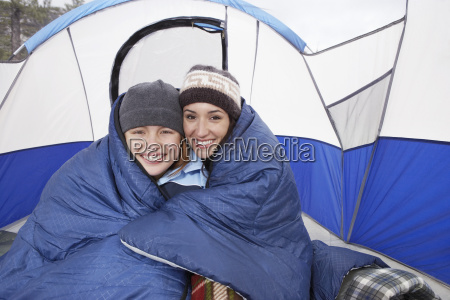 mother and daughter camping in winter