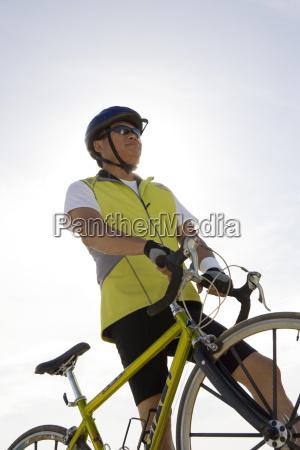 senior man by his bicycle