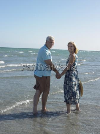 happy senior couple on tropical beach