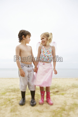 happy boy and girl holding hands