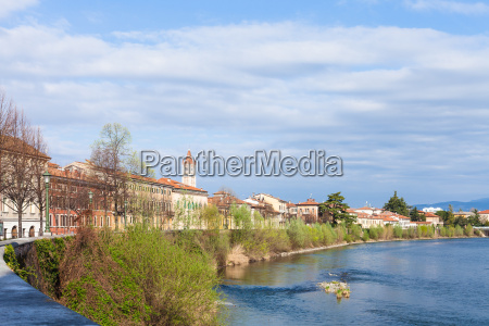 cityscape with waterfront of adige river