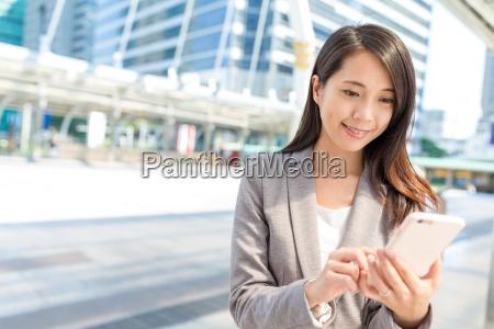 business woman using cellphone in bangkok