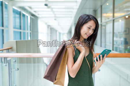 woman holding shopping bag and use