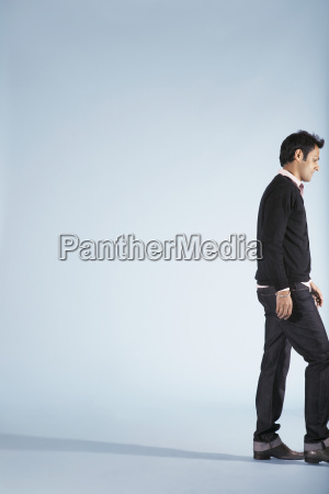 man walking on blue background