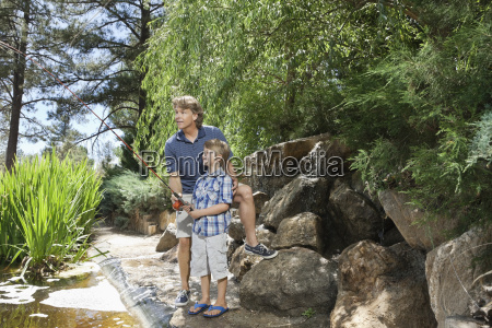 mature man with son fishing at