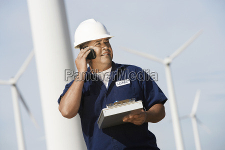 engineer using cell phone at wind