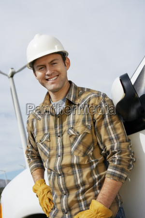 happy engineer at wind farm