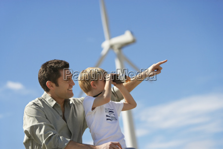boy with father at wind farm