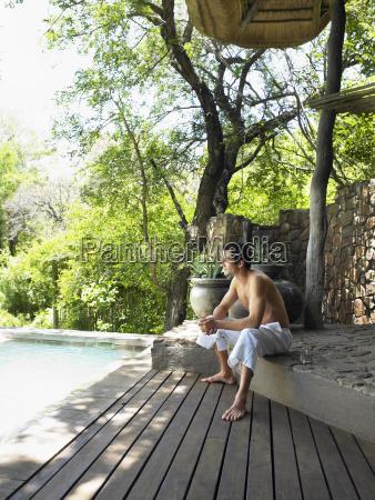 shirtless man enjoying the view on