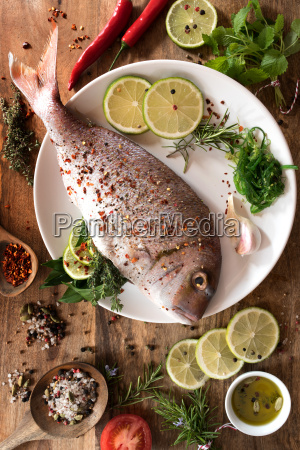 fish raw with spices and herbs