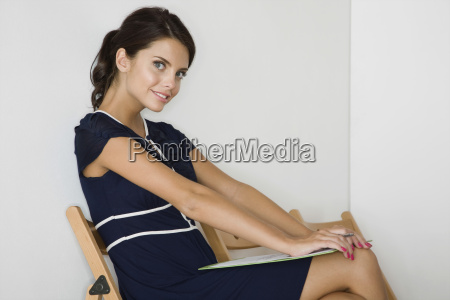 smiling woman in blue dress with