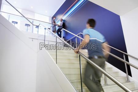 casual businessman walking up treppen