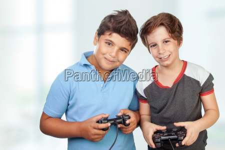happy boys playing video games