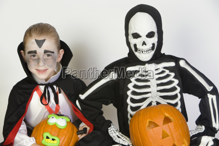 two boys dressed in halloween costumes