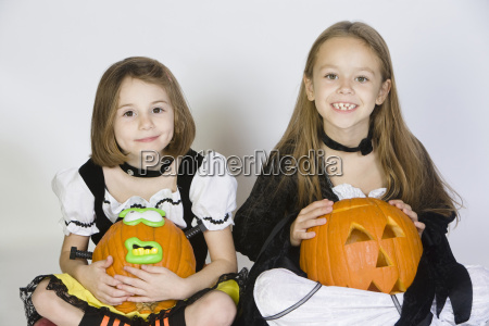 two girls dressed in halloween costumes