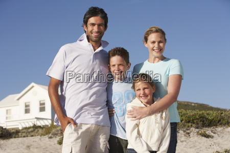 portrait of happy family on beach