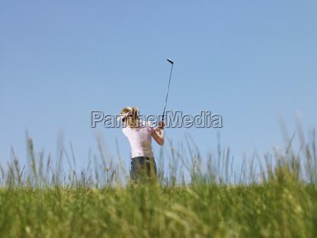 golfer swinging a golf club