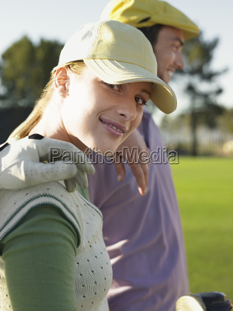female golfer with friends on golf