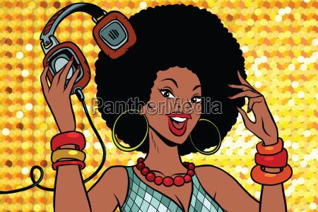 african american woman dj with headphones
