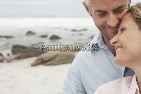 happy loving couple at beach