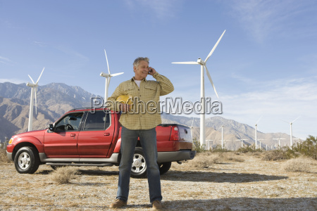senior man working at wind farm