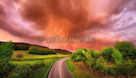 fascinating rain clouds over a road