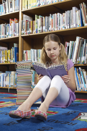 teenage girl studying in the library