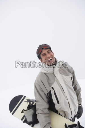 portrait of man with snowboard against